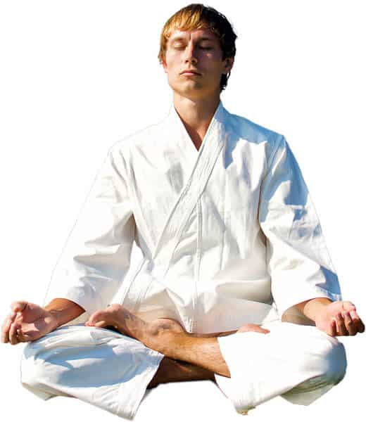 Martial Arts Lessons for Adults in Cypress TX - Young Man Thinking and Meditating in White