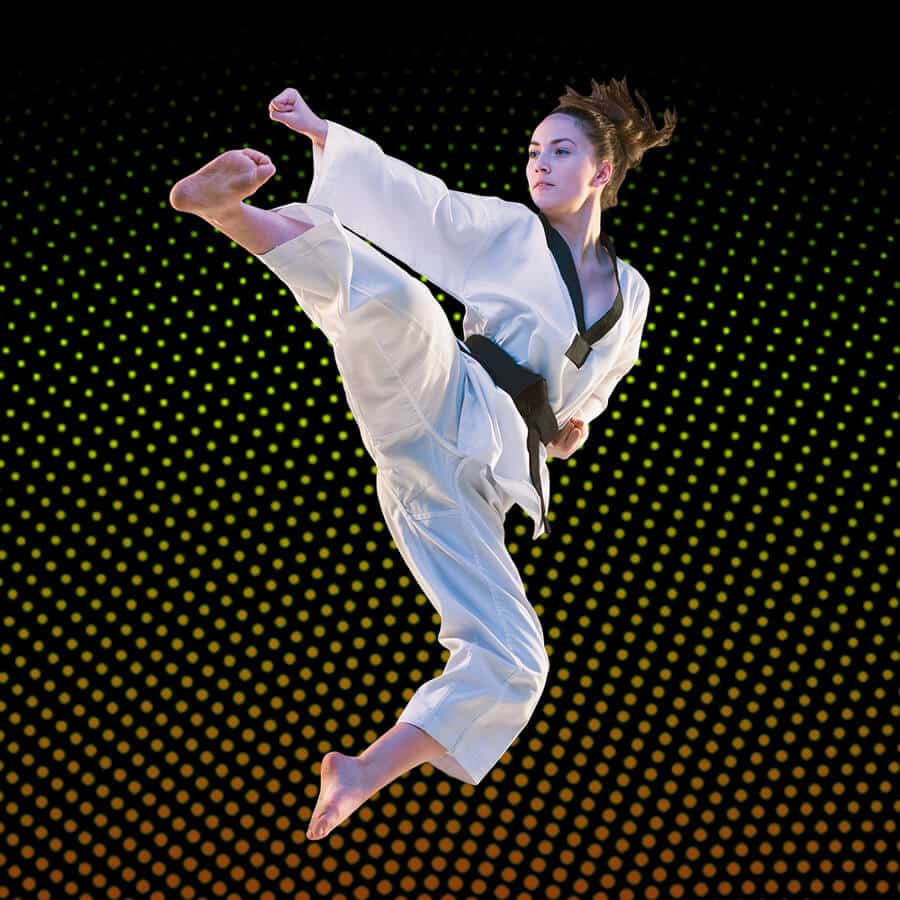 Martial Arts Lessons for Adults in Cypress TX - Girl Black Belt Jumping High Kick